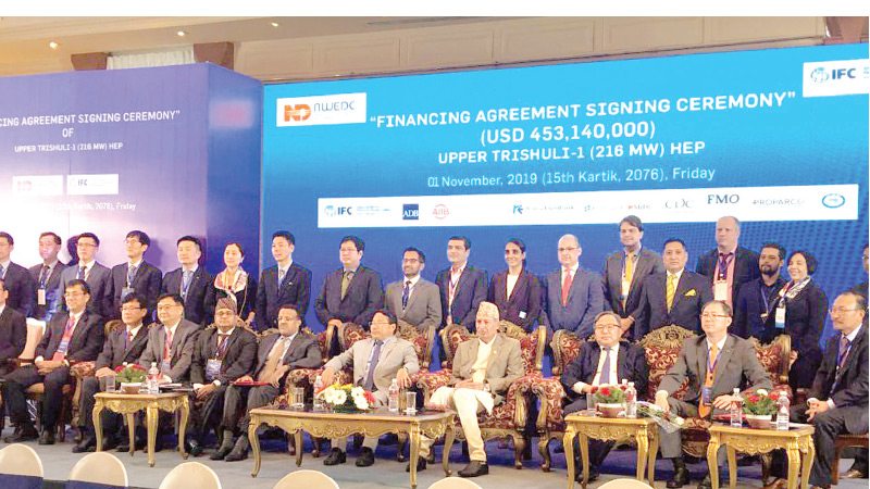 Representatives of development finance institutions, the project sponsor, and government officials after the signing of loans for the Upper Trishuli-1 Hydropower Project. Seated at the center table are Nepal Minister of Energy, Water Resources and Irrigation Barsha Man Pun  and Minister of Finance and ADB Governor Dr. Yuba Raj Khatiwada.