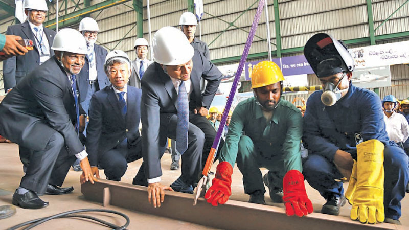(L to R) Managing Director Colombo Dockyard D. V. Abeysinghe, Minister of Ports Sagala Ratnayaka and Colombo Dockyard employees at the launch.  Picture by Sulochana Gamage