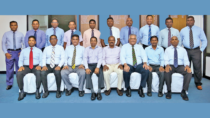 The first class umpires and umpire educators who were presented with a copy of 'Tom Smith's Cricket Umpiring and Scoring' by Sri Lanka Cricket.