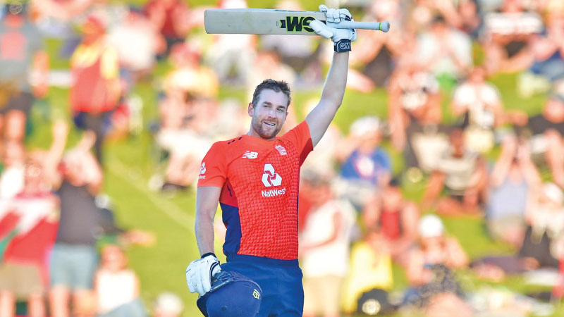 England's Dawid Malan celebrating his century during the Twenty20 cricket match against New Zealand at McLean Park in Napier on Friday. - AFP