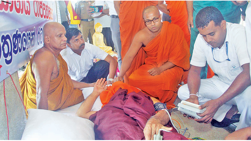 Ven.Inguruwatte Sumangala Thera being checked by medical staff yesterday. Picture by Chaminda Niroshan