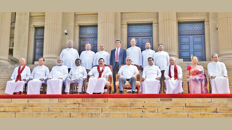 The new Cabinet Ministers with President Gotabaya Rajapaksa and Prime Minister Mahinda Rajapaksa at the Presidential Secretariat yesterday. Pictures by Wimal Karunathilake