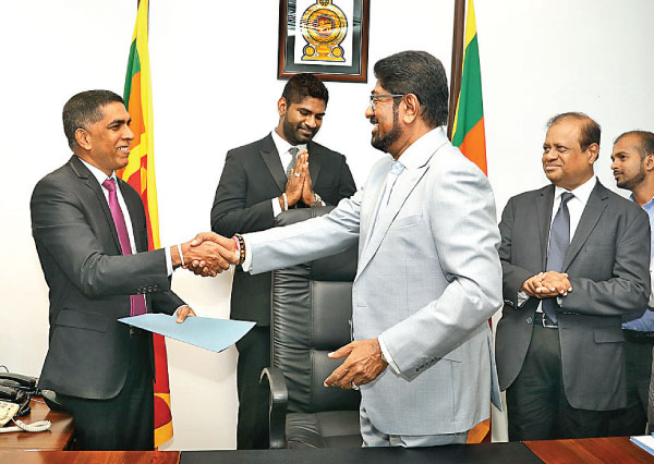 State Minister of Investment Promotion Keheliya Rambukwella assumes duties. Picture by Sudath Malaweera