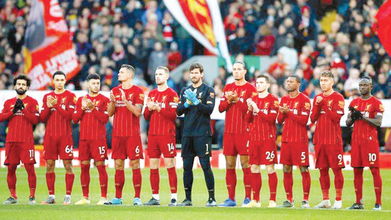 Liverpool players during a minutes silence before the match against Brighton & Hove Albion at Anfield on Saturday.