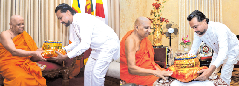 Minister Wimal Weerawansa with Chief Prelates Ven. Thibbatuwawe Sri Siddhartha Sumangala Thera and  Ven. Warakagoda Sri Gnanratane Thera. Pictures by Asela Kuruluwansa.
