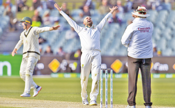 Australia's spinner Nathan Lyon (C) reacts after appealing successfully for an LBW decision against Pakistan's batsman Yasir Shah on the fourth day of the second Test cricket match in Adelaide on December 2. AFP