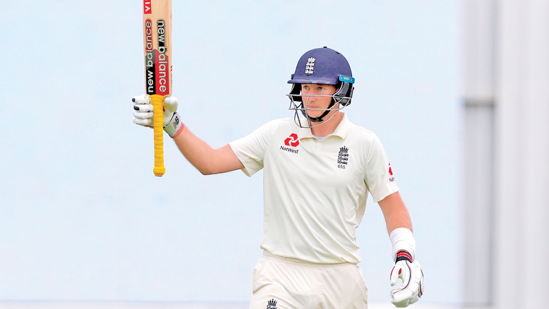 England's batsman Joe Root celebrates reaching 200 runs on day four of the second cricket Test match between England and New Zealand at Seddon Park in Hamilton on December 2. AFP