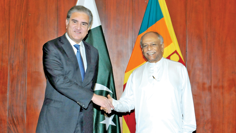 Foreign Minister Dinesh Gunawardena with Pakistani Foreign Minister Makhdoom Shah Mehmood Qureshi.