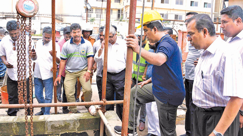 Roads and Highways, Ports and Shipping Minister Johnston Fernando during an inspection tour of the Colombo Port last Friday.