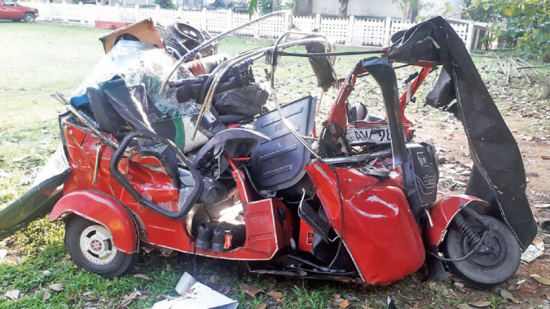 The mangled three wheeler at the Warakapola police station.Picture by Gamini Ramyapala.