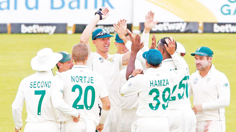 South Africans celebrate the fall of another England wicket on their way to a 107-run win in the first Test played at the Centurion.