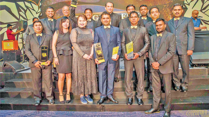 Trident Corporation team with the awards