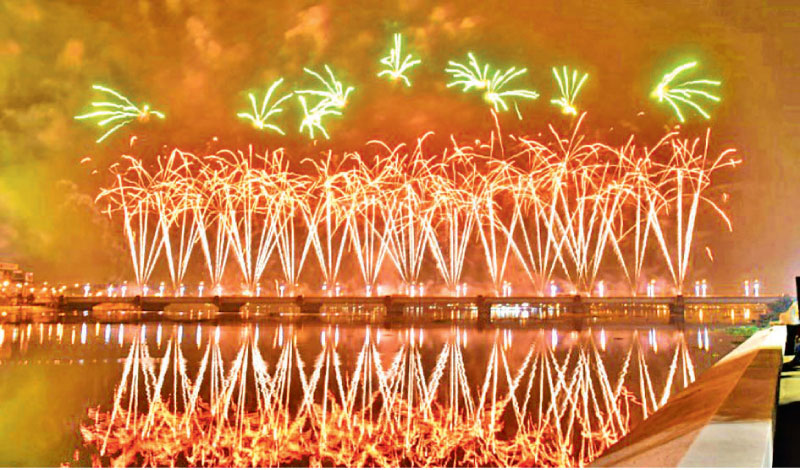 Fireworks light up the sky over the General de Gaulle bridge and the Ebrie lagoon during New Year's celebrations in Abidjan, Ivory Coast.