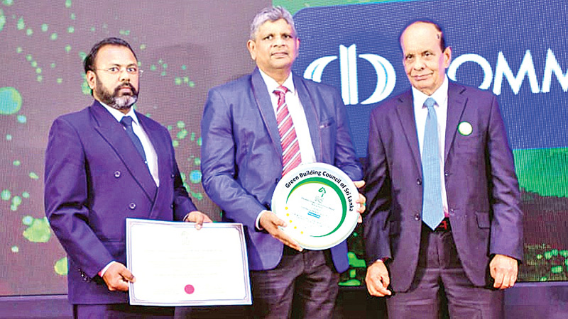 Commercial Bank's Junior Engineer – Premises Department K. K. D. Ravindra Kamburawala and Chief Manager – Premises Department Tilak Wakista with the Excellent Green Commitment Awards presented to the Bank by GBCSL.