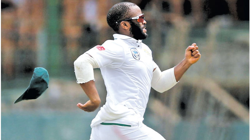 The cap of the South Africa's Temba Bavuma falls off as he runs to stop the ball.