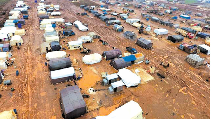 An aerial photograph shows tents sheltering Syrians who fled ongoing battles in the southern and eastern coutryside of the Idlib province. - AFP