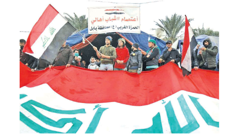 Iraqis protest at Baghdad's Tahrir Square against the political system, demanding the ouster of the ruling elite they consider inept and corrupt.