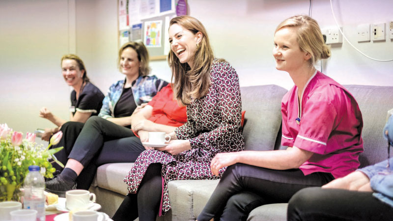 A handout photograph released by Kensington Palace shows Britain's Catherine, Duchess of Cambridge, speaking with staff during the time in November she spent at Kingston Hospital's Maternity Unit. - Kensington Palace has released four new photographs of The Duchess of Cambridge, taken in November during the time Her Royal Highness spent at Kingston Hospital's Maternity Unit.