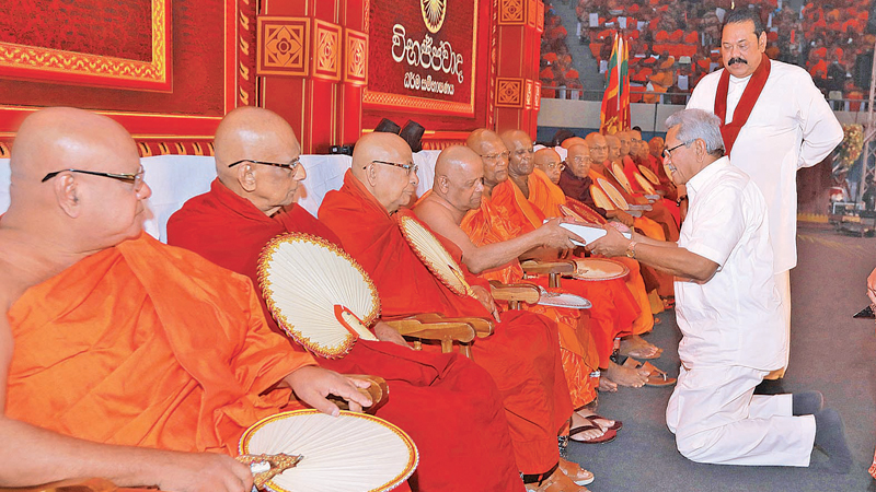 DONATION OF TRIPITAKA TABS TO MAHA SANGHA: President Gotabaya Rajapaksa and Prime Minister Mahinda Rajapaksa donated Tablet PCs containing the Tripitaka  to the Maha Sangha at the 'Vibhajjavada Dhamma Sangayana' event held at the Sugathadasa Indoor Stadium on Saturday. Picture courtesy President's Media Division.