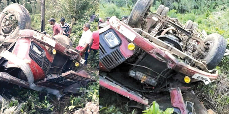 Area  residents seen searching for the injured following the bus accident at Passara yesterday.