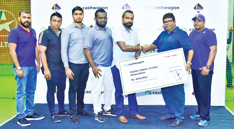 The sponsorship cheque being handed over to Hiran De Mel, Head of Technical and Operations for Ceylon Indoor Cricket Association by Samila Fernando , CEO (Lendtech Lanka). Thilina Buddhika, Digital Marketing Specialist (Lendtech Lanka), Janaka Bandara, Manager, Information Technology (Lendtech Lanka), Suhail Nazeemudeen , Manager , Digital Sales and Marketing (Lendtech Lanka), Asitha Dewapura, Deputy Collections Manager (Lendtech Lanka) and  Asela Pathirana ( Coach ) were also present .