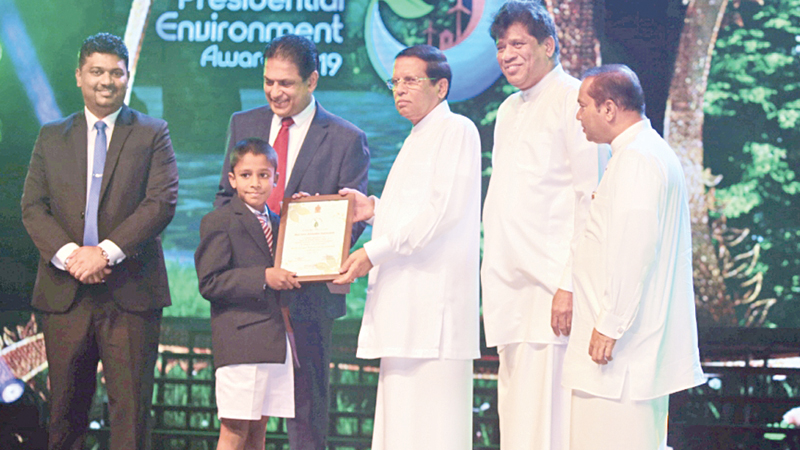 Receiving the Special Blue Green Award from former President Maithripala Sirisena