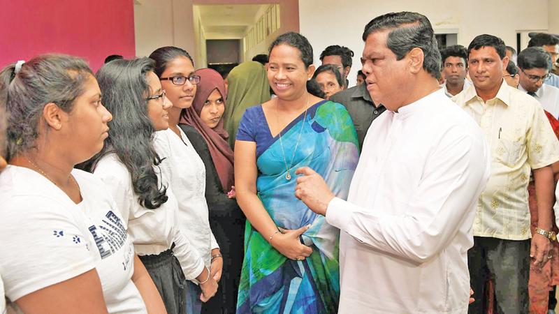 Health Minister Pavithra Wanniarachchi and Information and Communication Technology and Higher Education, Technology and Innovations Minister Bandula Gunawardena speaking to students at the event.