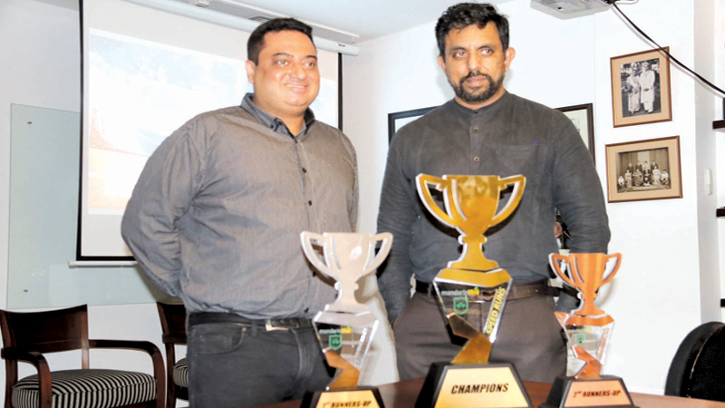Sheran Cooke, Chairman organizing Committee 'Speed Runs' and Prashad Subramaniam Managing Director of Mandarin Reid Advertising the organizers of 'Speed Runs' with the trophies on offer.