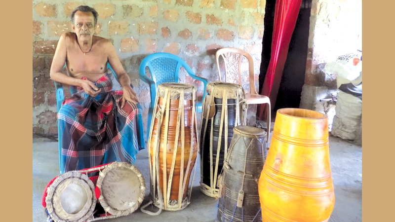 Nandasena with some of his products