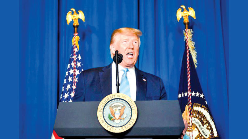 US President Donald Trump makes a statement on Iran at the Mar-a-Lago estate in Palm Beach Florida, on January 3, 2020. - AFP