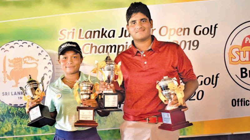 Sri Lanka Junior Golf Champions Taniya Minel Balasuriya and Nirekh Tejwani with their trophies. Picture by Herbert Perera