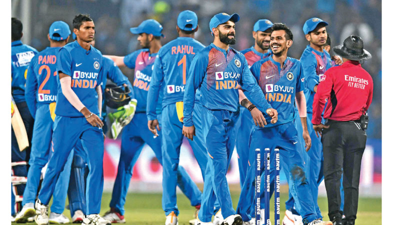 India's players celebrate after winning the third T20 cricket match against Sri Lanka at the Maharashtra Cricket Association stadium in Pune on January 10, 2020. AFP