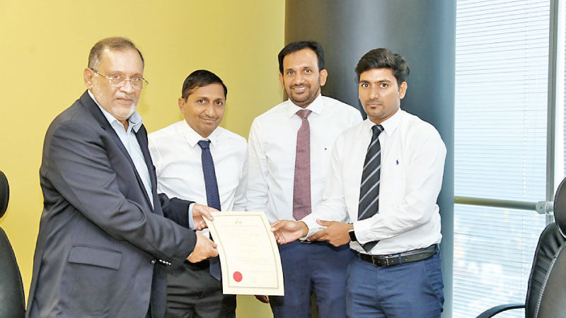 Susantha Ratnayake Chairman of the BOI formally hands over the certificate of registrations to Dr Anoopkanth Segar, Director of Sands Active (Private) Limited.