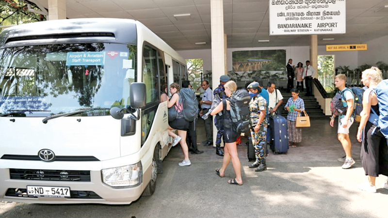 Air passengers travelling to the Bandaranaile International Airport, Katunayake seen boarding one of the buses.