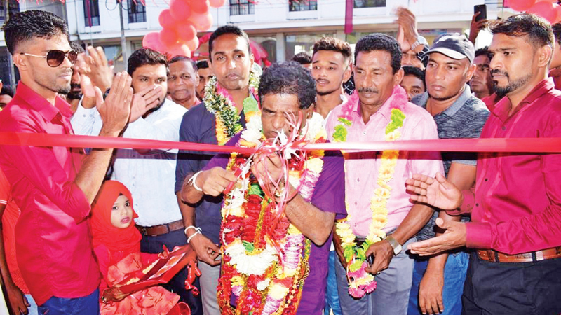 The Chief Guest, State Minister Wimalaweera Dissanayake  opens the new party office.