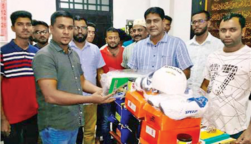 Eastern Provincial Councilor A.L. Thavam donating  Sports gear