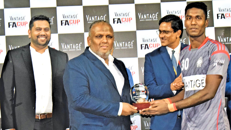 The Police Sports Club Goal Keeper receives the Player of the match award from. Rasmi Raheem, Chairman Ebony Holding Ltd, while Anura De Silva, President FFSL, looks on at the awards ceremony.   PICTURES BY – HERBERT PERERA