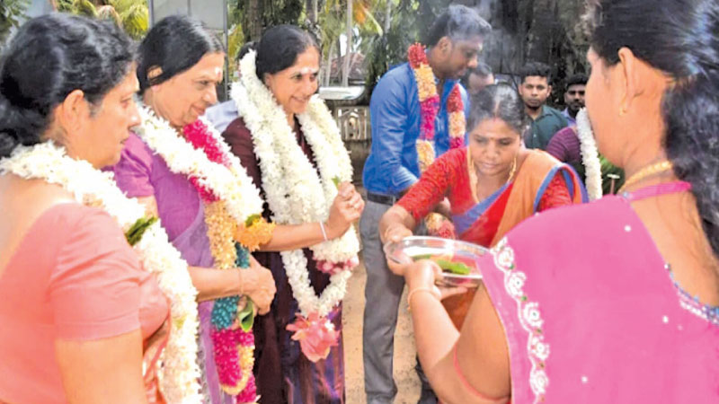 Eastern Province Governor Anuradha Yahampath interacts with war widows of the province, in Batticaloa recently.