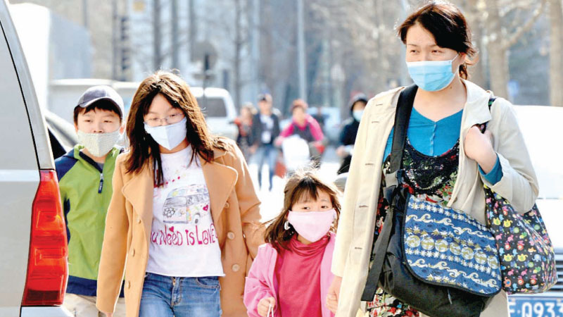 A Chinese family wearing face masks.