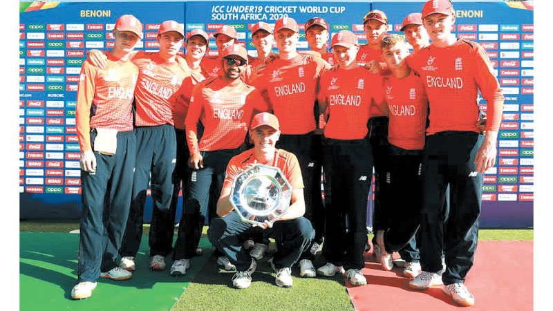 The England Under 19 cricketers with the ICC U19 Cricket World Cup Plate Trophy.