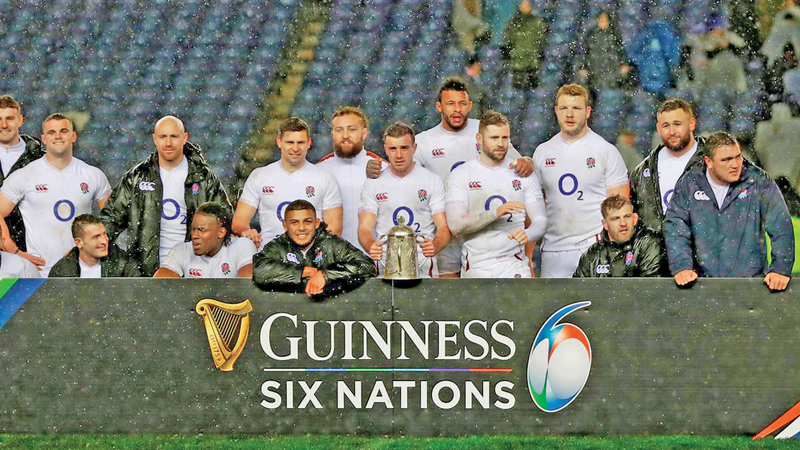 England players pose for a photograph as they celebrate with the Calcutta Cup after the match.