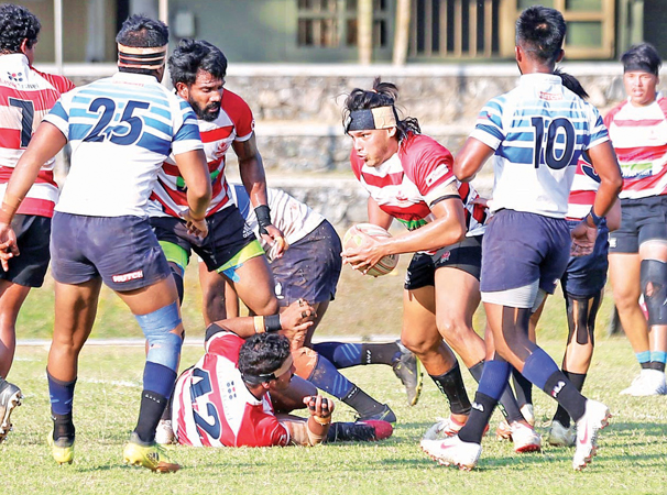 CH & FC Flyhalf Rohitha Rajapaksa with the possession of ball trying to penetrate Navy defence. Picture by Shan Rambukwella
