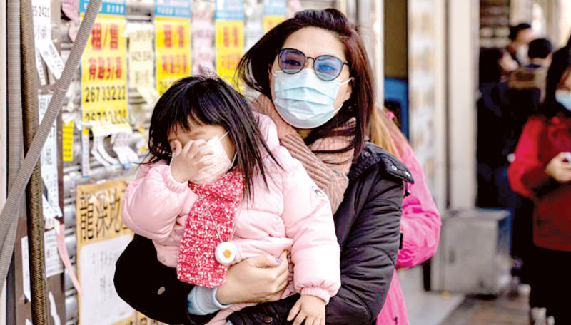 People wear face masks and walk at a shopping mall in Taipei, Taiwan
