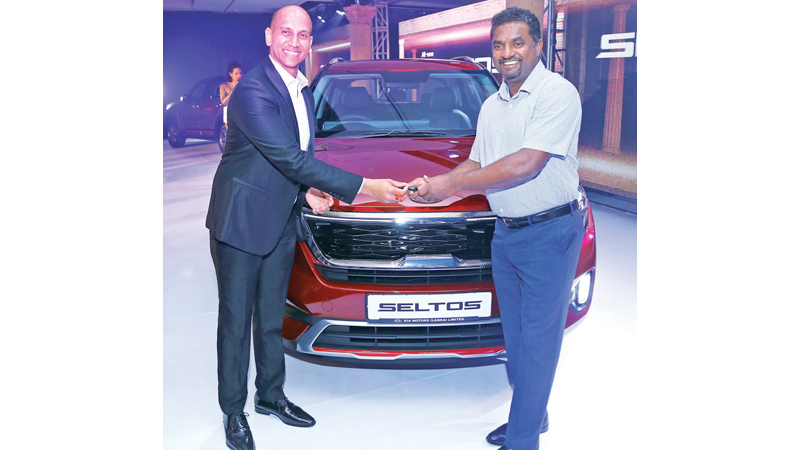 Muttiah Muralitharan and Kia Motors Chief Executive Officer Andrew Perera. Pictures by  Sulochana Gamage