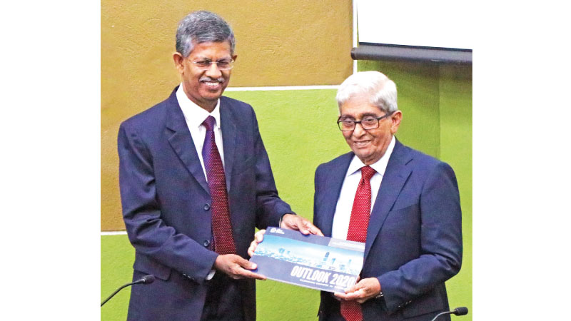 Secretary General and CEO of the Chamber, Manjula de Silva hands over the report to Governor, Prof W.D. Lakshaman