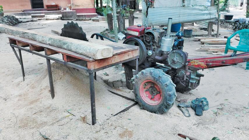 Seized teak timber, hand tractor and  bench.