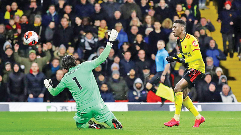 Watford's Ismaila Sarr scores their second goal against Liverpool.