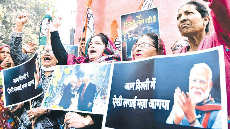 Indian National Congress workers shout slogans against Indian Prime Minister Narendra Modi during a protest in Amritsar on February 26, 2020.
