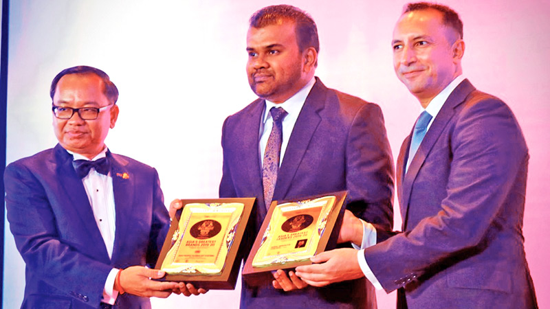 APTS Founder and Managing Director Namal Senaratna (center)  receives the two awards from Ouk Sorphorn, Ambassador  Extraordinary and Plenipotentiary, the Kingdom of Cambodia to the  Kingdom of Thailand (L) and Tarek Ahmed Fouad Raslan, Deputy Chief of  Mission, the Arab Republic of Egypt (R)