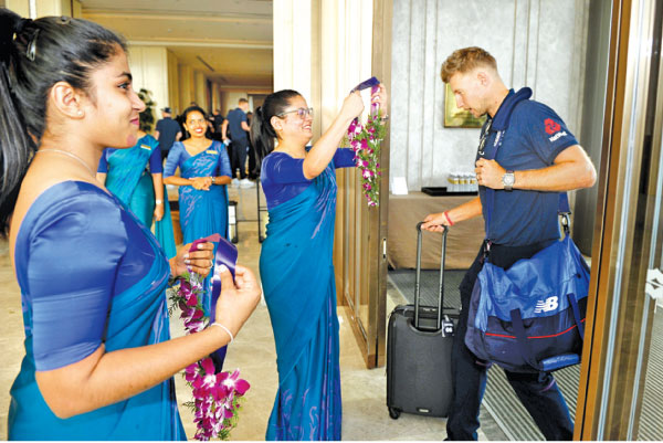 England cricket team captain Joe Root is welcomed by hotel staff on arrival in Sri Lanka yesterday. England will play a series of two Test matches during their short tour here in addition to two warm-up matches.